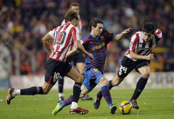 Messi regateando en San Mamés